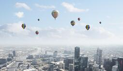 Conceptual image with colorful balloons flying high in sky.jpeg